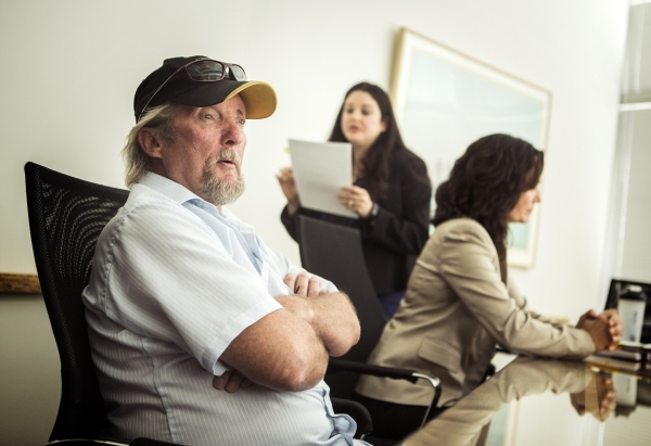 Wayne Fischer,left,  talks about how his finances were hurt by taking out a car-title loan during an interview at Legal Aid Center of Southern Nevada, 725 E. Charleston Boulevard on Friday, Sept.  ...
