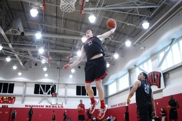 UNLV's Stephen Zimmerman Jr. (33) goes up for a dunk during a team practice inside Mendenhall Center at UNLV in Las Vegas Monday, Oct. 5, 2015. Erik Verduzco/Las Vegas Review-Journal Follow  ...