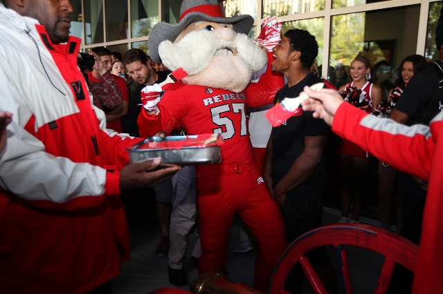 UNLV mascot Hey Reb! gets ready to brush red on the Fremont Cannon during a victory event for defeating the University of Reno in football outside of the Student Union at UNLV in Las Vegas Monday, ...
