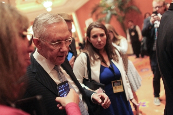 U.S. Sen. Harry Reid, D-Nev., answers questions from news media ahead of the CNN Democratic presidential debate at the Wynn hotel-casino in Las Vegas on Tuesday, Oct. 13, 2015. Chase Stevens/Las V ...