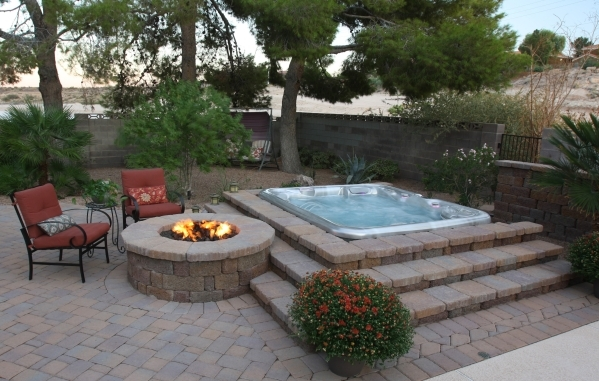 Spas By Renee worked with the homeowner's landscaper to install a six-person, champagne-opal acrylic interior HotSpring portable hot tub. The design includes a multistep paver buildup around ...
