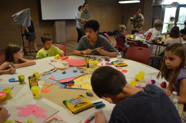 Children use crayons, markers, clay, sticks, rocks and more to craft ideas for the perfect playground during a brainstorming workshop at the Springs Preserve. (Ginger Meurer/Special to View)