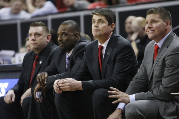 UNLV coaches, from left, Todd Simon, Stacey Augmon, Dave Rice and Ryan Miller watch a free throw attempt during the second half of their Mountain West Conference tournament game against UNR Wednes ...