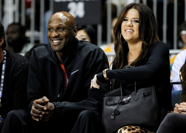 Lamar Odom and Khloe Kardashian sit courtside as they attend the BBVA All-Star Celebrity basketball game as a part of the NBA All-Star basketball weekend in Los Angeles in February 2011, Danny Mol ...