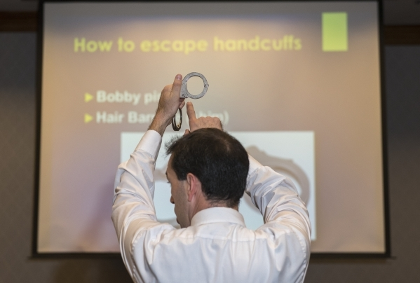 Former C.I.A. agent Jason Hanson demonstrates how to escape handcuffs during his Spy Escape & Evasion live training class at the Hampton Inn Tropicana in Las Vegas on Friday, Oct. 16, 2015. Ma ...