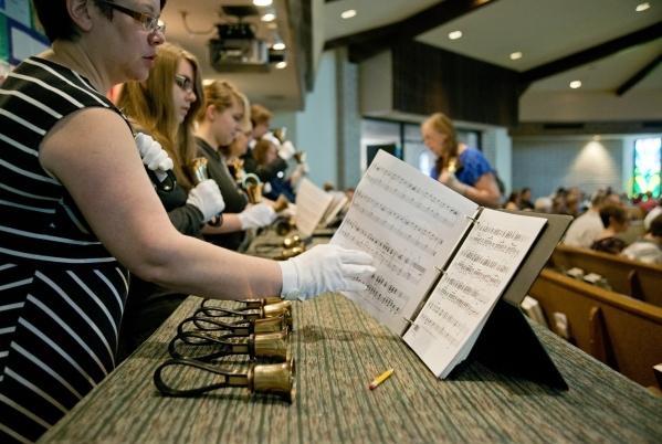 Kristen Elliott plays hand bells inside First Good Shepherd Lutheran Church during services celebrating their 75th anniversary on Sunday, Oct. 18, 2015. Daniel Clark/Las Vegas Review-Journal