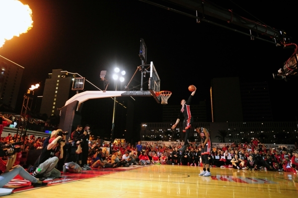 UNLV Runnin Rebels forward Stephen Zimmerman Jr. (33) jumps over forward Derrick Jones Jr. (1) to dunk the ball during the Runnin' Rebel Madness event at the Downtown Las Vegas Events Center ...