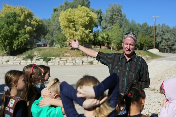 Wildlife biologist and volunteer Bruce Eilers, right, speaks to Girl Scouts Troop 109 visiting Gilcrease Nature Sanctuary Saturday, Oct. 24, 2015, in Las Vegas. The sanctuary, located at 8103 Race ...