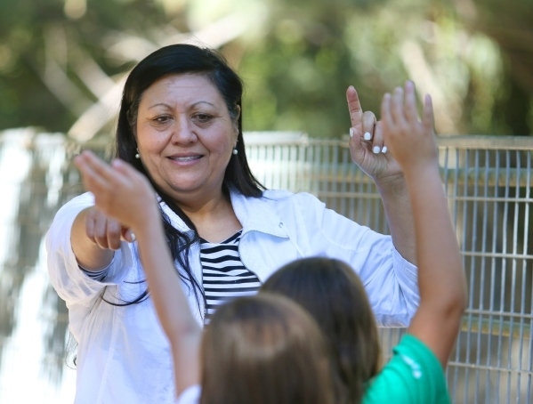 Volunteer and guide Sandra Salinas speaks to Girl Scouts Troop 109 members visiting Gilcrease Nature Sanctuary Saturday, Oct. 24, 2015, in Las Vegas. The sanctuary, located at 8103 Racel St., was  ...