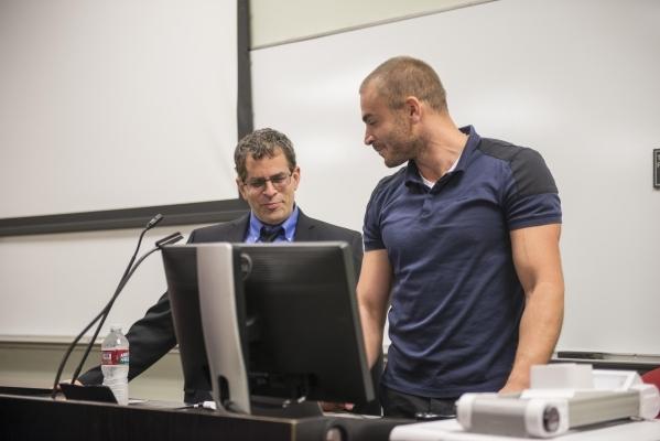 "UNLV professor Dr. Martin Schiller, left, speaks with Dr. Jeremy Koenig, CEO of Athletigen, before Koenig delivers the presentation ""Sports Genetics: A Global Study of Athletics"" at the  ..."