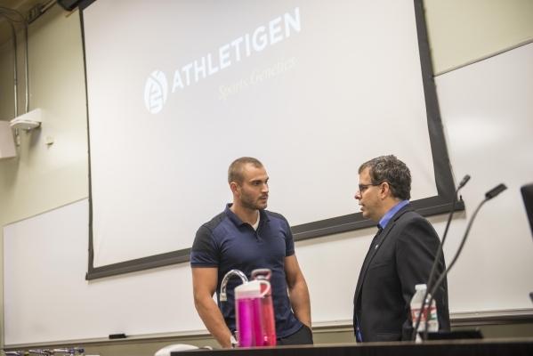 """Dr. Jeremy Koenig, left, CEO of Athletigen, speaks with UNLV professor Dr. Martin Schiller before Koenig delivers the presentation """"Sports Genetics: A Global Study of Athletics"""" at the N ..."""