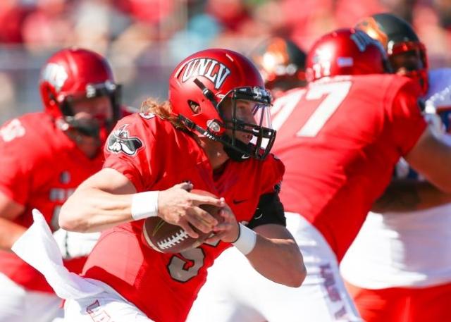 UNLV quarterback Blake Decker (5) runs the ball against Boise State during a football game at Sam Boyd Stadium in Las Vegas on Saturday, Oct. 31, 2015. (Chase Stevens/Las Vegas Review-Journal)