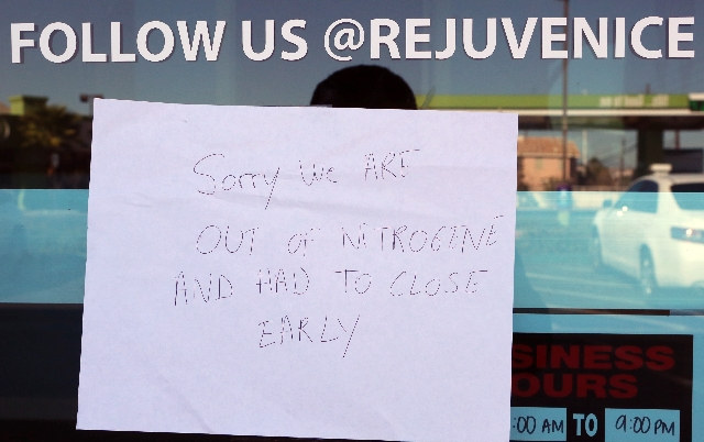 """A sign on the front door of Rejuvenice reads """" Sorry we are out of Nitrogene and had to close early"""" on Monday, Oct. 26 at 8846 S. Eastern Ave. in Henderson. Chelsea Ake-Salvacion, 24, o ..."""