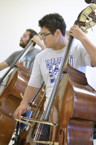 Bassists Jimmy Cisneros, left, and Diego Suarez perform during a Las Vegas Young Artists Orchestra rehearsal at 3661 S. Maryland Parkway in Las Vegas on Friday, Oct. 30, 2015. Bill Hughes/Las Vega ...