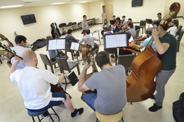 Yunior (cq) Lopez, center background, conducts during a Las Vegas Young Artists Orchestra rehearsal at 3661 S. Maryland Parkway in Las Vegas on Friday, Oct. 30, 2015. Bill Hughes/Las Vegas Review- ...