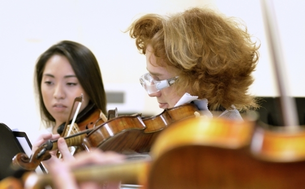 Violinists Waverly Tingel, left, and Wes Tyngriffith (cq) perform during a Las Vegas Young Artists Orchestra rehearsal at 3661 S. Maryland Parkway in Las Vegas on Friday, Oct. 30, 2015. Bill Hughe ...
