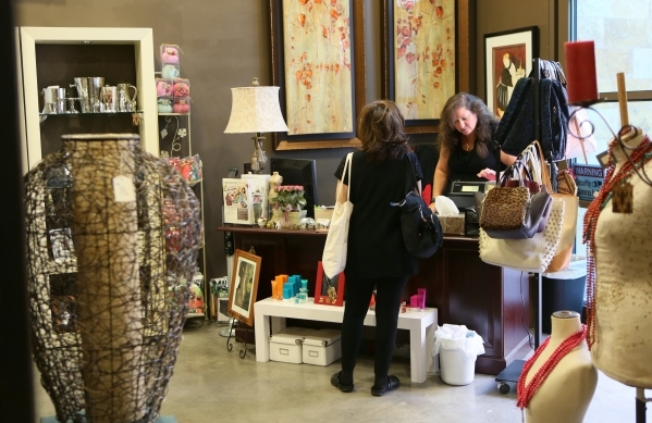 Michele Morgan, right, assists a customer at Dinosaur & Roses store at Tivoli Village Thursday, Oct. 29, 2015, in Las Vegas. Dinosaur & Roses´ newest location offers customers new and d ...