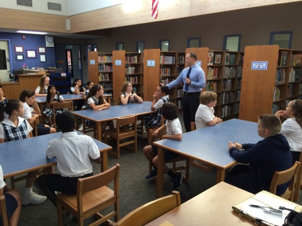 Al Giangregorio, special agent with the U.S. Department of Homeland Security, speaks to fifth-graders about staying safe while online Sept. 28 at The Meadows School. The talk included points about ...