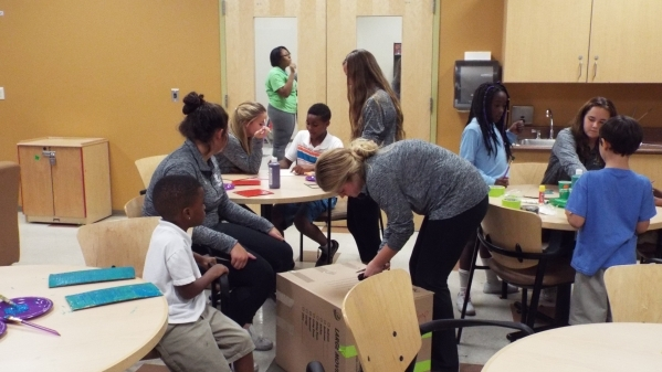 "The Faith Lutheran girls varsity soccer team volunteers Oct 22 at the Stupak Community Center. Along with ""bonding"" experiences such as team dinners, the team volunteers each year with a ..."