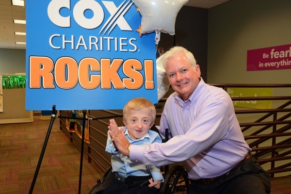 Michael Bolognini, vice president and market leader for Cox Communications Las Vegas, right, is shown with Best Buddies Nevada Ambassador, 12-year-old Daniel McCarty. Cox Charities recently awarde ...