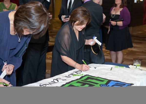 Attendees sign a keepsake flag during Nevada Donor Network's second annual Awards Gala on Oct. 24. The event honored those who have helped advance the mission of the network over the past ye ...