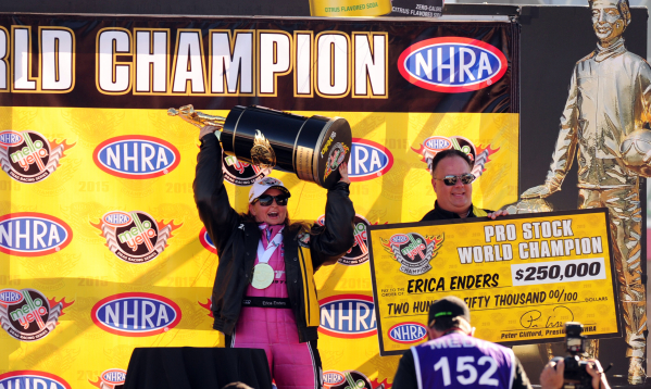Pro Stock driver Erica Enders-Stevens hoists the Mello Yello Pro Stock World Championship trophy after clinching it in the second round of eliminations of  the Toyota Nationals for the Mello Yello ...