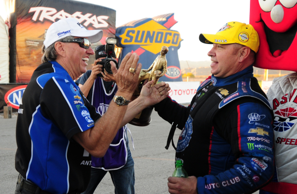 Funny Car driver Robert Hight, right, chats with team owner and fellow driver John Force after Hight won the Mello Yello NHRA Drag Racing Series Toyota Nationals at the Strip at Las Vegas Motor Sp ...
