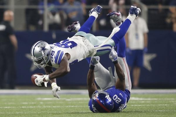 Sep 13, 2015; Arlington, TX, USA; Dallas Cowboys wide receiver Dez Bryant (88) catches the ball as New York Giants cornerback Prince Amukamara (20) tackles at AT&T Stadium. The Cowboys won 27- ...