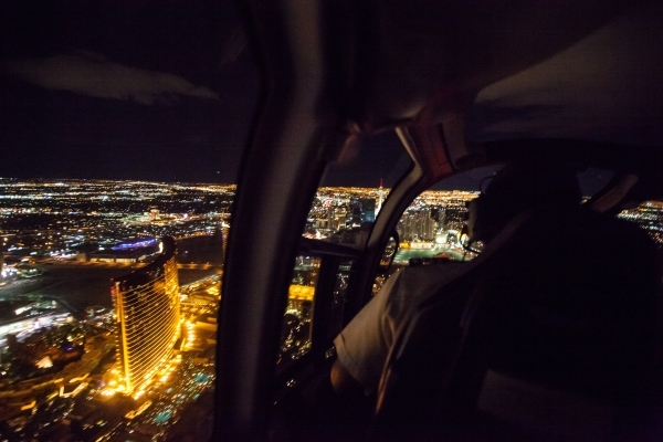 A helicopter pilot flies guests over the Las Vegas Strip as part of a holiday parter at Sundance Helicopters in Las Vegas on Thursday, Oct. 29, 2015. Chase Stevens/Las Vegas Review-Journal Follow  ...