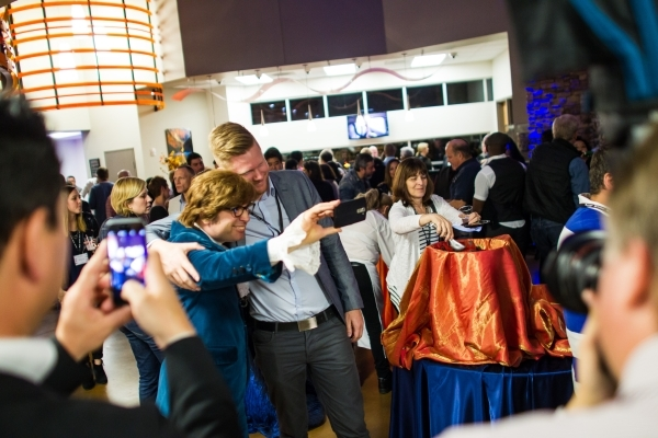 Austin Powers impersonator Richard Halpern takes a selfie with Daniel Johansson during a holiday party at Sundance Helicopters in Las Vegas on Thursday, Oct. 29, 2015. As a part of the event, whic ...