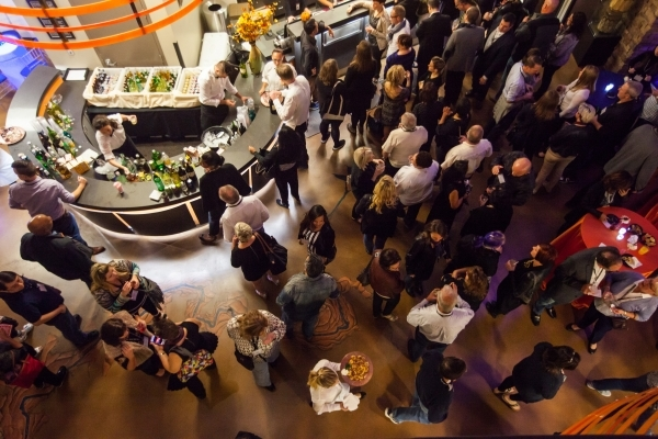 Guests attend a holiday party at Sundance Helicopters in Las Vegas on Thursday, Oct. 29, 2015. As a part of the event, which takes place in the terminal, guests go on a helicopter ride of the Las  ...