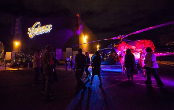 Guests arrive for a holiday party at Sundance Helicopters in Las Vegas on Thursday, Oct. 29, 2015. As a part of the event, which takes place in the terminal, guests go on a helicopter ride of the  ...