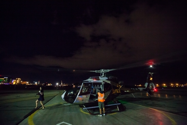 Sundance Helicopters staff guide guestsafter a helicopter ride at the Sundance Helicopters terminal in Las Vegas on Thursday, Oct. 29, 2015. As a part of the event, which takes place in the termin ...
