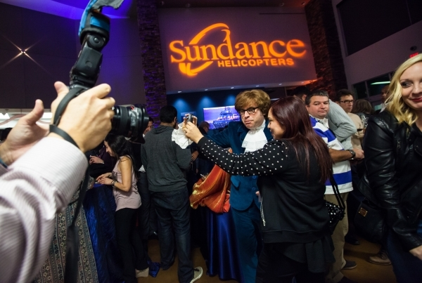Austin Powers impersonator Richard Halpern takes photos with guests during a holiday party at Sundance Helicopters in Las Vegas on Thursday, Oct. 29, 2015. As a part of the event, which takes plac ...