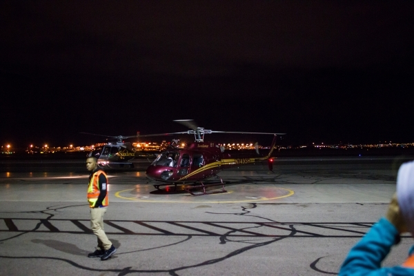 Sundance Helicopters staff prepare to guide guests for a helicopter ride at the Sundance Helicopters terminal in Las Vegas on Thursday, Oct. 29, 2015. As a part of the event, which takes place in  ...