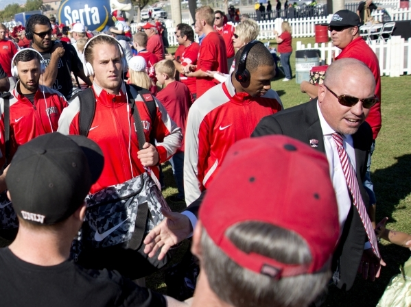 UNLV football head coach Tony Sanchez, right, enters the Rebel Block Party with his team outside Sam Boyd Stadium before their game against Boise State on Saturday, Oct. 31, 2015. A number of spon ...