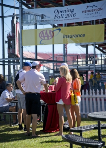 VIP guests are seen in front of AAA signage during the UNLV Rebel Block Party outside Sam Boyd Stadium before their game against Boise State on Saturday, Oct. 31, 2015. A number of sponsors have s ...
