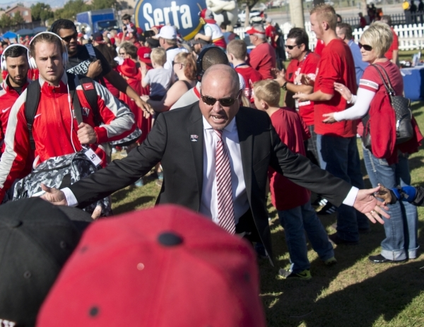 UNLV football head coach Tony Sanchez, center, enters the Rebel Block Party with his team outside Sam Boyd Stadium before their game against Boise State on Saturday, Oct. 31, 2015. A number of spo ...