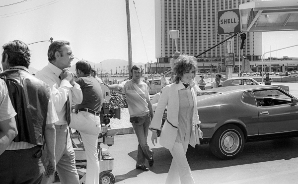 "Production of the James Bond movie  ""Diamonds Are Forever"" starring Sean Connery, second from left, and Jill St. John in front of the International Hotel and Casino, (later the Las Vegas ..."