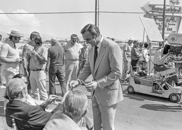 """Production of the James Bond movie  """"Diamonds Are Forever"""" starring Sean Connery, center, and Jill St. John in front of the International Hotel and Casino, (later the Las Vegas Hilton Hi ..."""