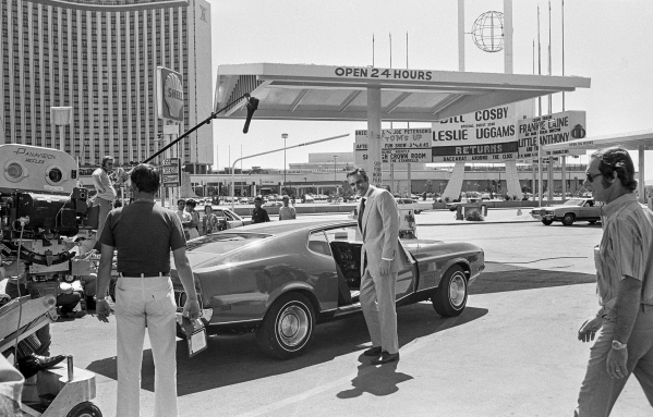 "Production of the James Bond movie  ""Diamonds Are Forever"" starring Sean Connery, center, and Jill St. John in front of the International Hotel and Casino, (later the Las Vegas Hilton Hi ..."