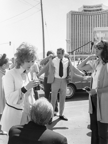 "Production of the James Bond movie  ""Diamonds Are Forever"" starring Sean Connery, center, and Jill St. John, left, in front of the International Hotel and Casino, (later the Las Vegas Hi ..."
