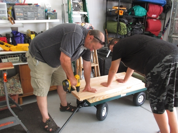 Craig Vallone, 16, works on his Eagle Scout Project with carpenter, Jim Markichevich, in summer 2015. Vallone designed a Western-themed sandbox on wheels for Spirit Therapies. (Special to View)