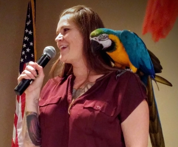 Amanda Crowder's blue and gold macaw Loki sits on her shoulder as she speaks during the Las Vegas Avicultural Society's Oct. 10 visit to Las Ventanas, 10401 W. Charleston Blvd. Crowder ...