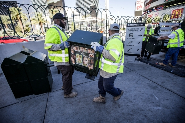 Clark County Public Works employees Harold Hardwick,left, and Edward Johnson installs a new newsrack in front of Harley-Davidson Cafe, 3725 South  Las Vegas Boulevard, on Monday, Nov. 2, 2015. The ...