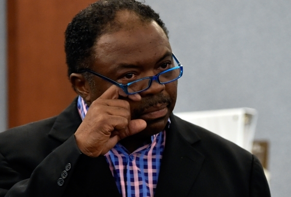 Tehran Boldon, younger brother  of murder victim Michael Bolden, wipes his eye as he gives his testimony during Ammar Harris's penalty hearing at the Regional Justice Center on Monday, Nov.  ...