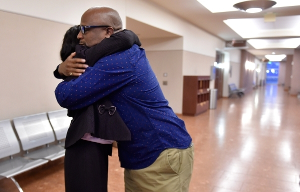Kenneth Cherry Sr., right, father of victim Kenny Cherry and Jean Trimble, the sister of victim Michael Boldon embrace after giving their testimony at Ammar Harris's penalty hearing at the R ...
