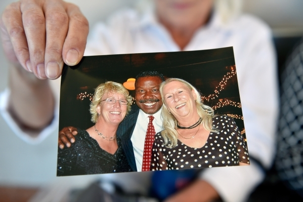 A photograph is displayed by Beth Hultgren of herself, right, and her long time boyfriend and victim, Michael Boldon, center, before Ammar Harris's penalty hearing at the Regional Justice Ce ...