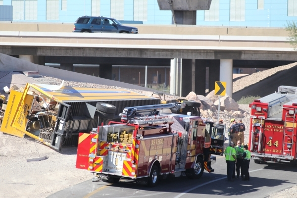 The U.S. Highway 95 northbound ramp onto northbound Interstate 15 is blocked while crews work at the scene of a rollover accident involving a moving truck. Bizuayehu Tesfaye/Las Vegas Review-Journ ...