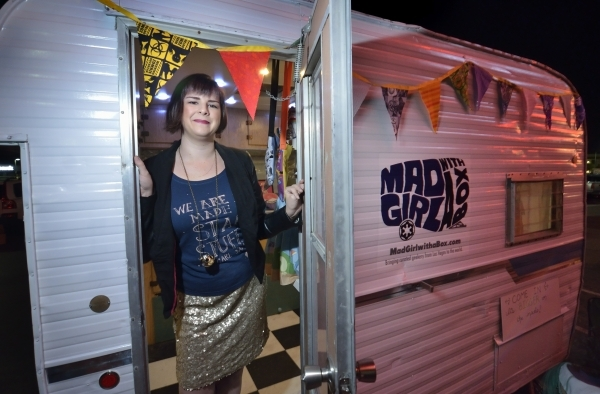Melanie Davis, CEO and owner of Mad Girl with a Box, is shown in the trailer she uses for her mobile retail business specializing in geeky merchandise during a business launch party at High Scores ...
